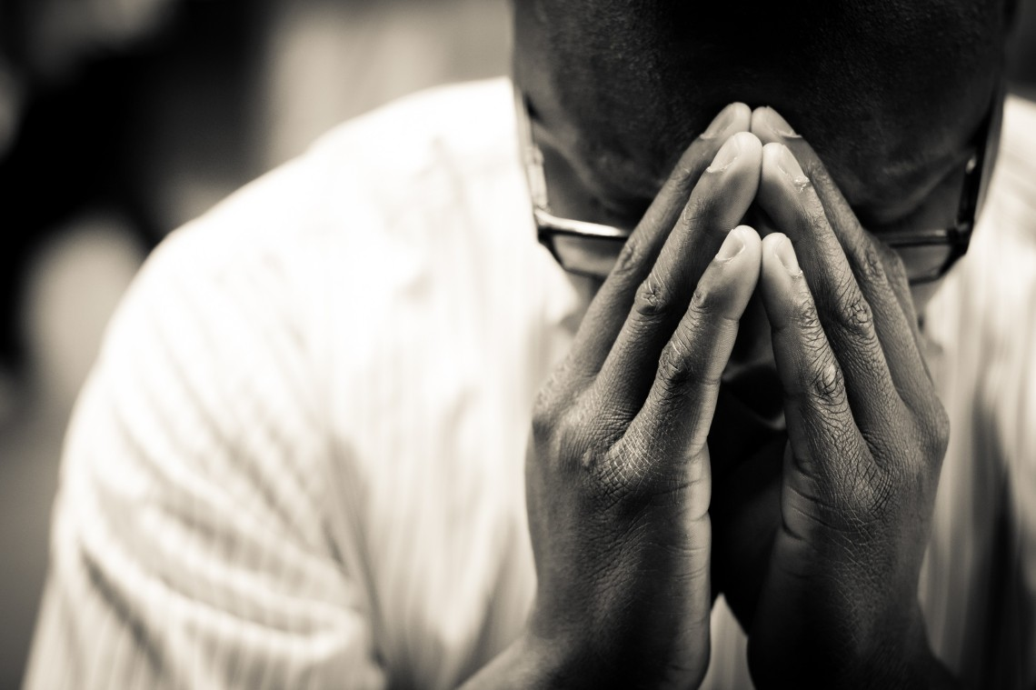Man-In-Prayer-Christian-Stock-Photo